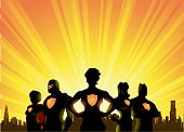 A silhouette style illustration of a team of superheroes with female leader with city skyline and sunburst in the background. Wide space available for your copy.