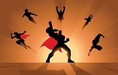 A vector illustration of a team of superheroes charging ready for action silhouette style