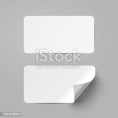 Vector white realistic paper adhesive stickers with curved corneron transparent background.
