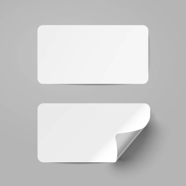 Vector white realistic paper adhesive stickers with curved corneron transparent background. Vector white realistic paper adhesive stickers with curved corneron transparent background. label stock illustrations