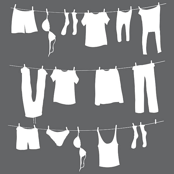 Vector White Silhouettes of Laundry on a Rope Vector  White Silhouettes of Laundry on a Rope wet clothing women t shirt stock illustrations