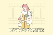 Vegan food, housewife, eco concept. Young happy woman or girl puts food in bags. Happy lady in a good mood chooses the best vegetables and fruits for her family. Shopping on site. Simple flat vector.