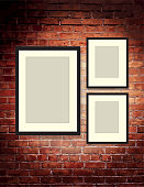 Vector illustrationRustic old fashioned brick wall background with three blank frames. Poster design or invitation template, easy to edit on separate layers. Includes spot light and strings with lot's of texture on a textured brick wall. Perfect for art gallery, home decor, wall poster, comedy night, entertainment, stage show, theatrical show, special improv comedy night.