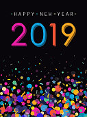 Vibrant greeting card for New Year 2019 with confetti and 2019 number placed on black background.