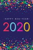 Vibrant Happy New Year 2020 greeting with flat designed confetti placed on dark blue background.