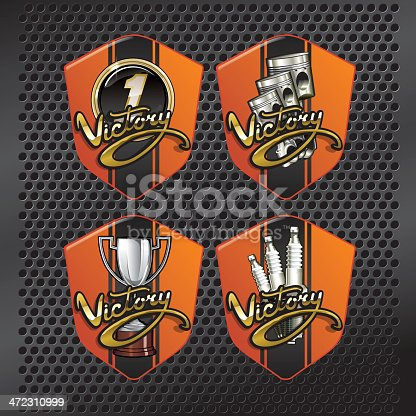 Four versions of Victory lettering emblem with racing elements, first place plaque, silver trophy, pistons and spark plugs. All over metallic grille.