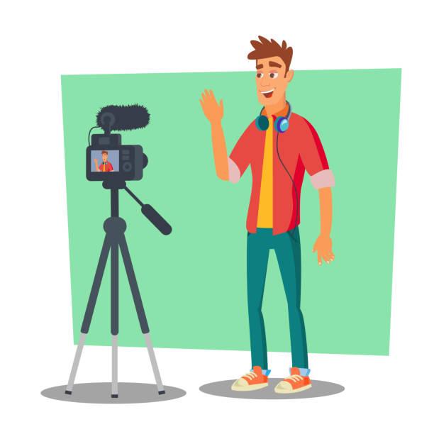 stockillustraties, clipart, cartoons en iconen met video blogger vector. vrolijke jonge blogger man. vlog concept. schieten video clip. platte cartoon afbeelding - green screen