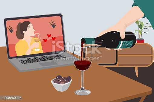istock Video call date. Adult people are making a pre-meal aperitif with wine together at home using teleconference platform apps 1298269297