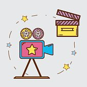 istock video camera with clapper board and filmstrips 668888484