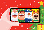 vector illustration of video chatting with Santa Claus and friends
