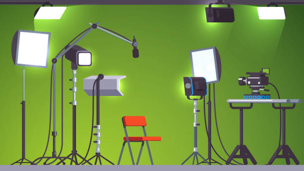 Video & movie production studio set lighting equipment, spotlights & floodlights, camera on rails, microphone on crane, chroma key green background. Flat style isolated vector Green screen television studio with stage lighting equipment, microphone with stand and professional camera on rails. Video production and broadcasting. Flat style vector illustration isolated studio stock illustrations
