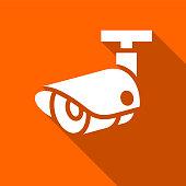 white surveillance camera on a orange square