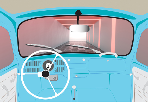 View inside of vintage beetle car driving through tunnel