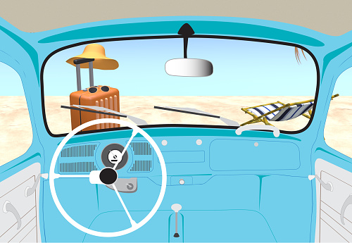 View inside of vintage beetle car driving to beach on summer holiday vacation