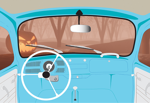 View inside of vintage beetle car driving to the horror darkness forest