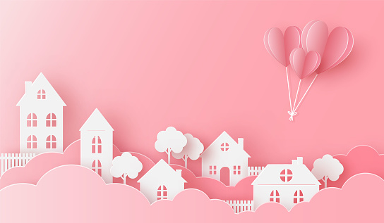 Views of the house in love with heart balloon flying on the pink sky
