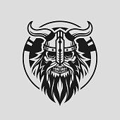 Stylized viking head skull silhouette in helmet with horns on shield - cut out vector icon