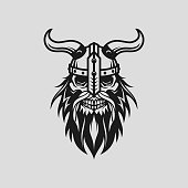 Stylized viking head skull with beard in helmet with horns - cut out vector silhouette