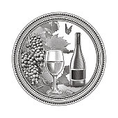 Engraved illustration of Vineyard grapes and glass of wine in circle frame
