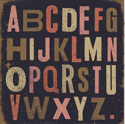 Vintage alphabet dark background