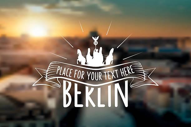 vintage berlin-schild auf verschwommene sonnenuntergang panorama - berlin brandenburger tor blurred stock-grafiken, -clipart, -cartoons und -symbole