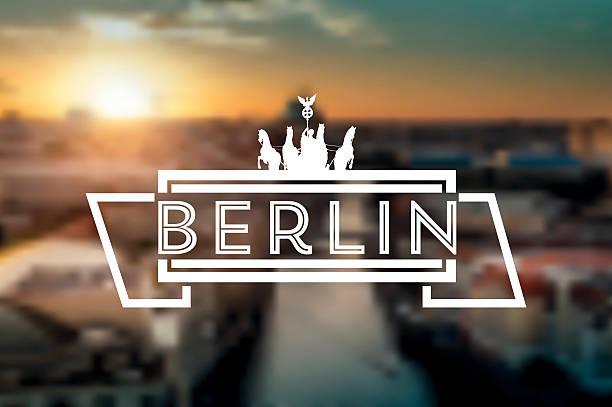 vintage berlin-schild auf verschwommene sonnenuntergang skyline - berlin brandenburger tor blurred stock-grafiken, -clipart, -cartoons und -symbole