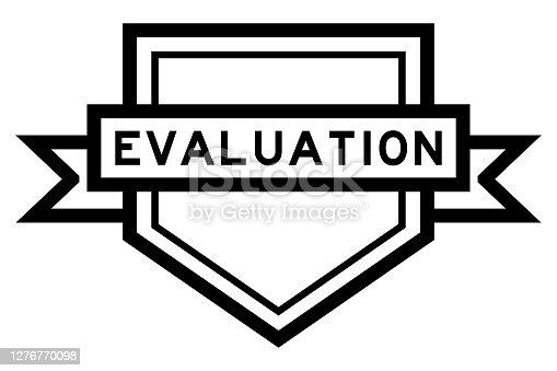 Vintage black color pentagon label banner with word evaluation on white background