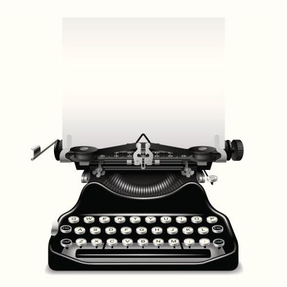 Vintage black typewriter ready for some words
