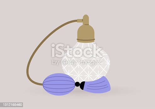 istock A vintage bottle of perfume decorated with a pump and a tassel, elegant lifestyle, old fashioned objects 1312165460