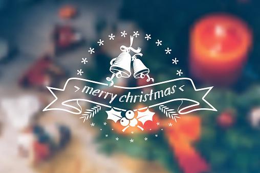 vintage christmas bells line ornament on blurred christmas table