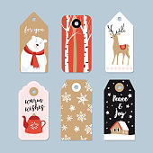 Vintage Christmas gift tags set. Hand drawn labels with birch trees, deer, polar bear and tea pot, isolated vector illustration objects.