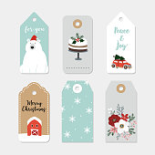 Vintage Christmas gift tags set. Hand drawn labels with winter flowers, cake, car with Christmas tree, polar bear, snowflakes and farm house. Isolated vector illustration objects.