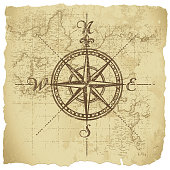 Vintage compass on parchment paper background. All elements are separate objects, grouped and layered. File is made with gradient. Global color used. 300dpi jpeg included. Please take a look at other works of mine linked below.