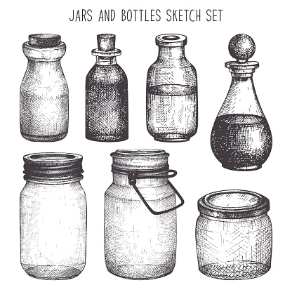 Vintage decorative glass canning jars isolated on white.