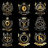 Vintage decorative heraldic vector emblems composed with elements like eagle wings, religious crosses, armory and medieval castles, animals. Collection of classy symbolic illustrations.