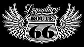 Vintage emblem of route 66 with wings on dark background.