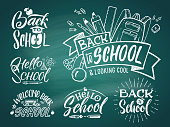 Vintage emblem set for school and university. Welcome to school. Vector hand writing words. Back to school text doodle on chalkboard illustration