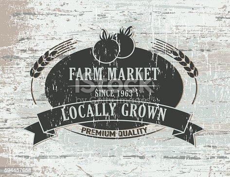 istock Vintage Faded Farm Sign On Wood Background 594457658