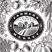 Vintage Farmers Market label with fruits and vegetables in woodcut style. Black and white editable vector illustration with clipping mask.
