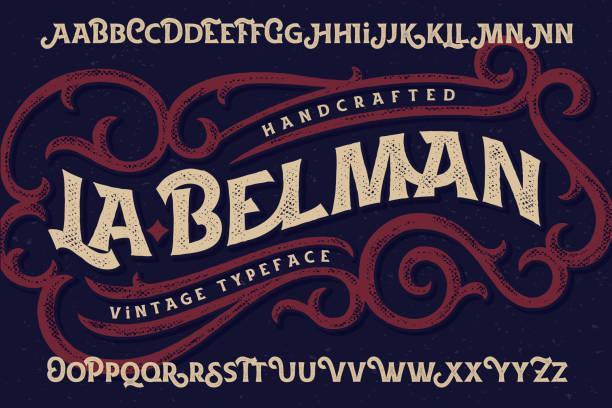 """vintage schriftart namens """"la belman"""" mit rau texturierte verzierten elementen - steampunk stock-grafiken, -clipart, -cartoons und -symbole"""