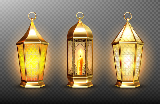 Vintage gold arabic lanterns with glowing candles