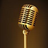 Vintage golden studio microphone isolated on dark background