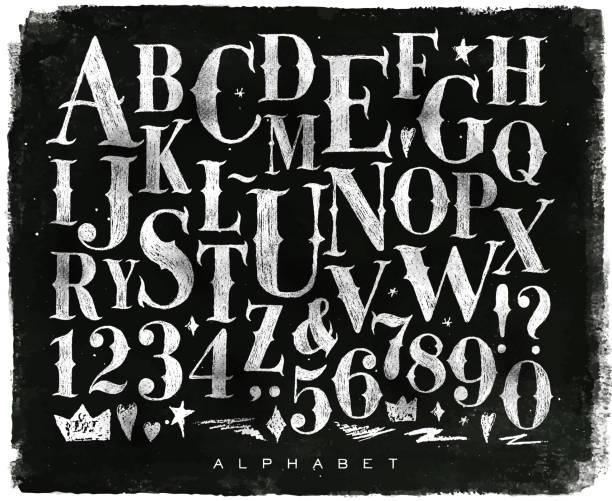Vintage gothic alphabet chalk Vintage gothic font in retro style drawing with chalk on chalkboard background alphabet symbols stock illustrations