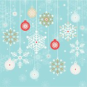 Hanging christmas baubles and snowflakes on a blu background.
