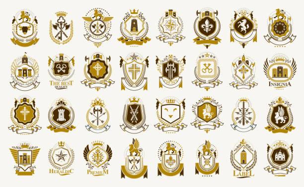 vintage heraldyczne emblematy wektor duży zestaw, antyczne heraldyki symboliczne odznaki i nagrody kolekcji, klasyczne elementy stylu, emblematy rodzinne. - insygnia stock illustrations