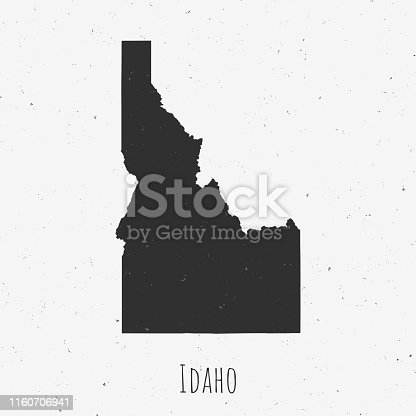 Black and white Idaho map in trendy vintage style, isolated on a dusty white background. A grunge texture is used to have a retro and worn effect. His name is written on the bottom of the image. Vector Illustration (EPS10, well layered and grouped). Easy to edit, manipulate, resize or colorize.