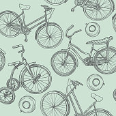 A seamless retro-looking line artwork pattern of three different types of bicycles and bike bells.