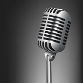 Vintage metal studio microphone isolated on dark background