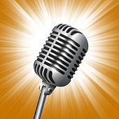 Vintage metal studio microphone isolated on shining light background