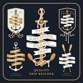 Vintage nautical anchor and ribbon labels set on dark striped background